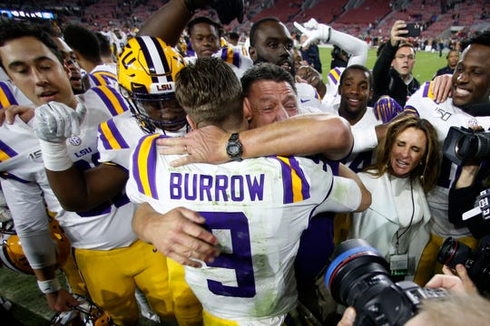 LSU head coach Ed Orgeron embraces quarterback Joe Burrow (9) after defeating Alabama 46-41 in an NCAA college football game, Saturday, Nov. 9, 2019, in Tuscaloosa, Ala. (AP Photo/John Bazemore)