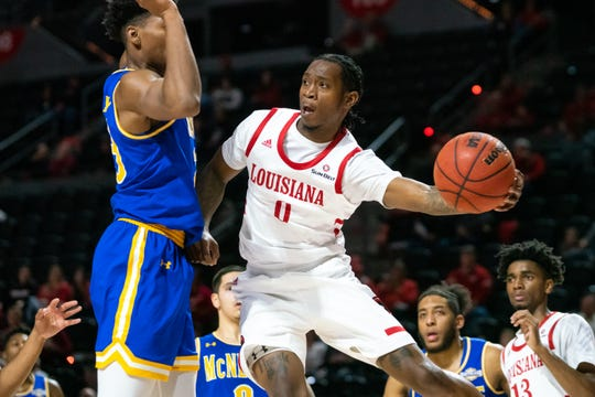 UL junior guard Cedric Russell passes the ball during last Friday night's win over McNeese at the Cajundome.