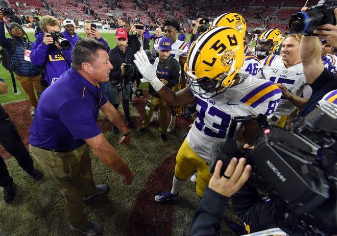 Nov 9, 2019; Tuscaloosa, AL, USA; LSU Tigers head coach Ed Orgeron celebrates midfield with his players following the Tigers 46-41win over the Alabama Crimson Tide at Bryant-Denny Stadium. Mandatory Credit: John David Mercer-USA TODAY Sports