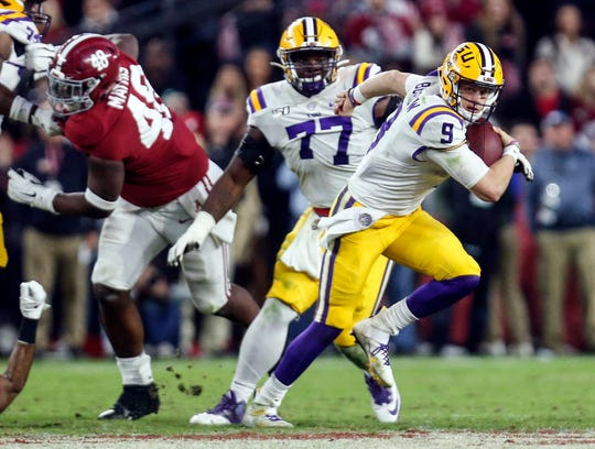 Nov 9, 2019; Tuscaloosa, AL, USA; LSU Tigers quarterback Joe Burrow (9) scrambles away from pressure against the Alabama Crimson Tide during the second half at Bryant-Denny Stadium. Mandatory Credit: Butch Dill-USA TODAY Sports