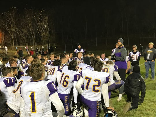 Bloom-Carroll coach Wade Bartholomew talks with his team after their 48-39 playoff win against Indian Valley Saturday night.