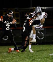 Amanda-Clearcreek's Jayse Miller tackles Columbus Academy's Sam Huyghe Saturday night, Nov. 9, 2019, at Amanda-Clearcreek High School in Amanda. The Aces won the first round playoff game 41-10.