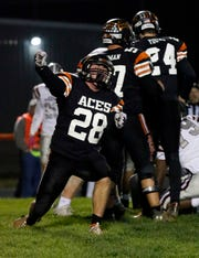 Amanda-Clearcreek's Quintin Lott celebrates an Aces' tackle Saturday night, Nov. 9, 2019, at Amanda-Clearcreek High School in Amanda. The Aces won the game 41-10 over Columbus Academy.