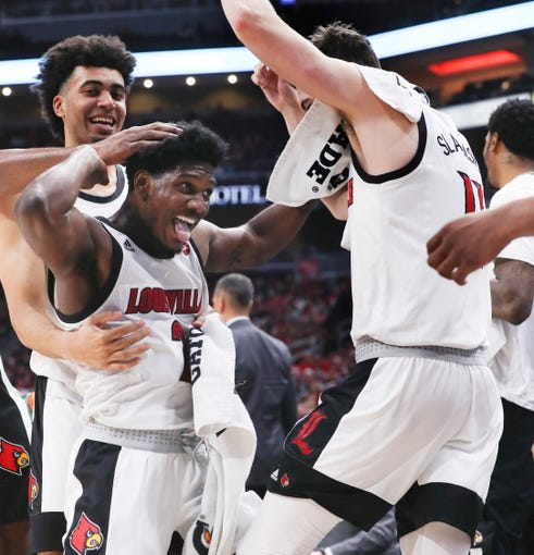 U of L guard Darius Perry (2) celebrated with teammates Jordan Nwora (33), left, and Quinn Slazinski (11) during the closing seconds of their win against Youngstown State at the Yum Center on Nov. 10, 2019
