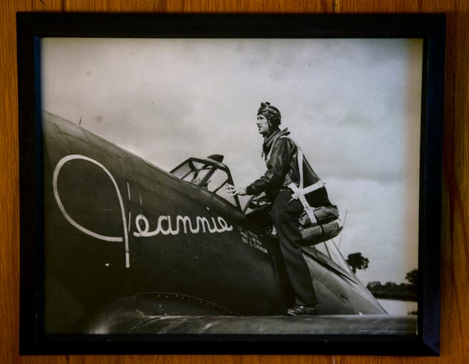 John Treitz with the P-47 Thunderbolt plane he flew in WWII. He painted his wife's name Jeannie on it's side. Nov. 08, 2019