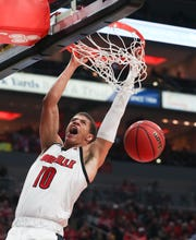 U of L forward Samuell Williamson (10) dunked against Youngstown State during their game at the Yum Center on Nov. 10, 2019