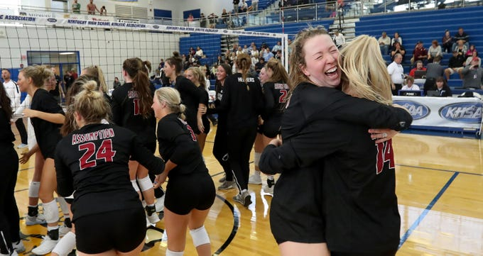 Assumption Rylee Rader and Anna DeBeer hug during their teams celebration of winning the Kentucky State Volleyball Championship over Mercy in three sets on Nov. 10, 2019.