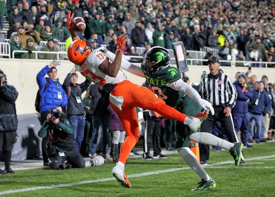 Nov 9, 2019; East Lansing, MI, USA; Michigan State Spartans cornerback Josh Butler (19) is called for pass interference against Illinois Fighting Illini wide receiver Caleb Reams (13) during the second half of a game at Spartan Stadium. Mandatory Credit: Mike Carter-USA TODAY Sports
