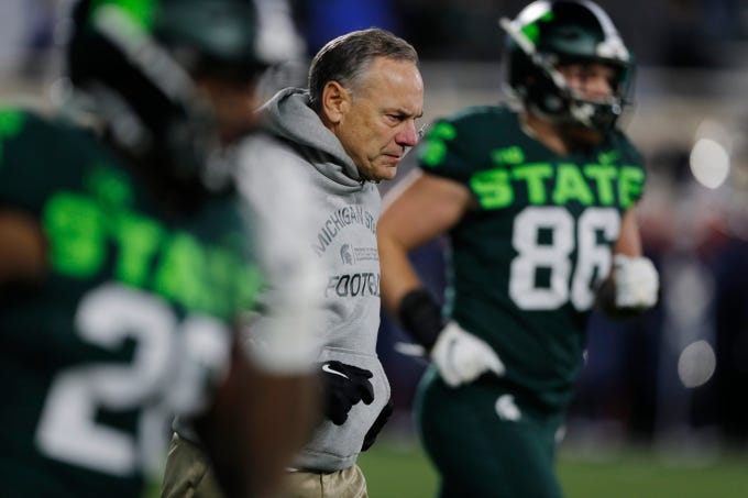 Michigan State head coach Mark Dantonio runs onto the field to start the second half of an NCAA college football game against Illinois, Saturday, Nov. 9, 2019, in East Lansing, Mich. (AP Photo/Carlos Osorio)