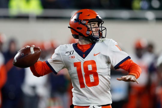 Illinois quarterback Brandon Peters throws during the second half of an NCAA college football game against Michigan State, Saturday, Nov. 9, 2019, in East Lansing, Mich. (AP Photo/Carlos Osorio)