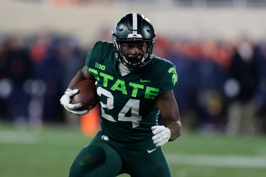 Michigan State running back Elijah Collins (24) rushes during the second half of an NCAA college football game against Illinois, Saturday, Nov. 9, 2019, in East Lansing, Mich. (AP Photo/Carlos Osorio)