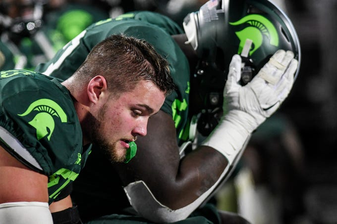 Michigan State's Kenny Willekes sits stunned on the bench after Illinois' go-ahead touchdown late in the fourth quarter on Saturday, Nov. 9, 2019, at Spartan Stadium in East Lansing.