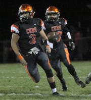 Lucas' Logan Niswander (3) and Ethan Sauder (10) each made big plays late in an overtime victory over McDonald on Saturday.