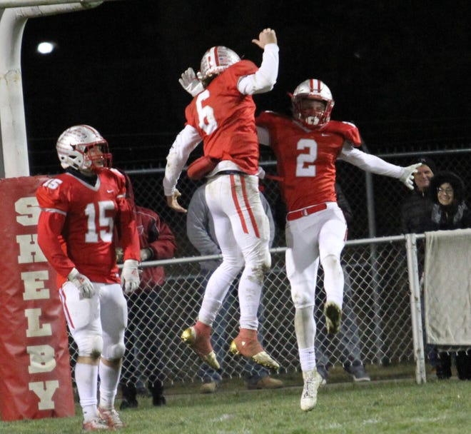Shelby quarterback McGwire Albert (6) and receiver Blaine Bowman (2) celebrate their hookup on the decisive 92-yard touchdown in Saturday's 31-21 win over Milan Edison in the Division IV regional quarterfinals.