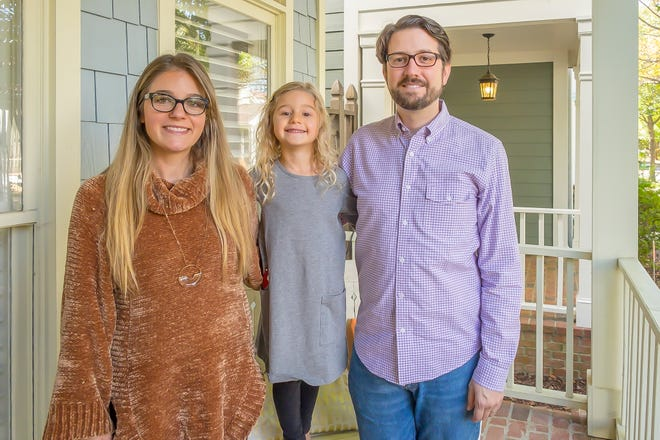 Renee and Thomas Cole and their daughter, Stella, love their new home in Harbor Town section near Downtown Memphis.