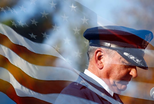 Retired Maj. Gen. Dexter Tutor speaks to the crowd gathered for a Veterans Day ceremony at the West Tennessee State Veterans Cemetery on Sunday, Nov. 10, 2019. This image was created with a double-exposure technique, where two photos have been merged on the camera to create a single image.