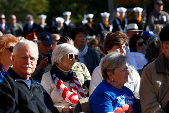 People gather for a Veterans Day Ceremony at the West Tennessee State Veterans Cemetery on Sunday, Nov. 10, 2019.