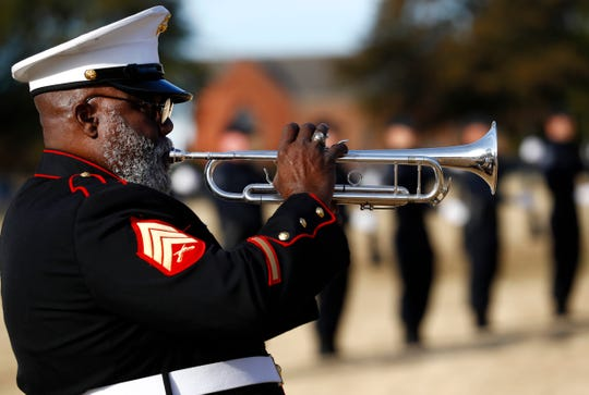 Marine Sgt. Charly Wells Sr. plays the bugle during a Veterans Day Ceremony at the West Tennessee State Veterans Cemetery on Sunday, Nov. 10, 2019.