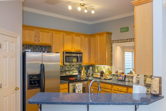 The kitchen in this Harbor Town home is a gathering place for the Cole family.