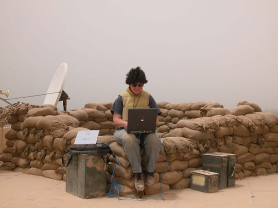 Milwaukee Journal Sentinel reporter Meg Jones transmits her story and photos from the roof of Patrol Base Olson in Samarra, Iraq in June 2005.