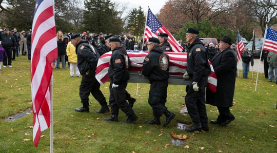An honor guard carries the remains of Army Staff Sgt. James L. Van Bendegom during graveside services Nov. 11, 2014, at Sunset Ridge Memorial Park Cemetery in Kenosha. Van Bendegom was captured in Vietnam in July 1967 when his patrol was overrun by enemy forces.