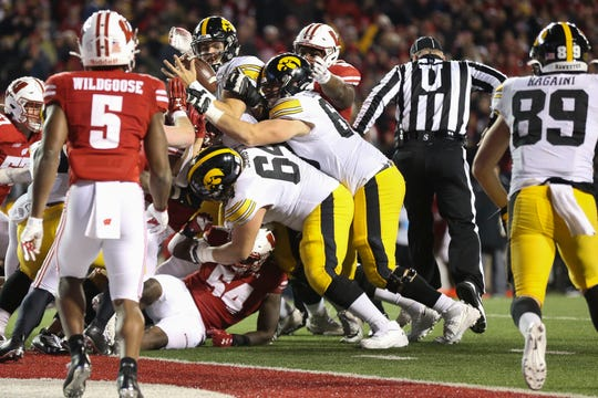 The Badgers defense stuffs Iowa quarterback Nate Stanley just short of the goal line during a two-point conversion attempt with 3:12 left in the game.