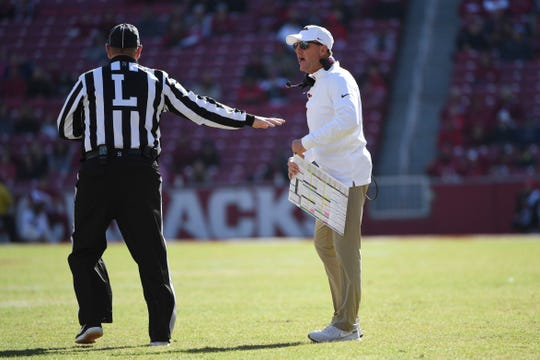 Arkansas coach Chad Morris talks with an official during the second half against Western Kentucky on Saturday in Fayetteville.