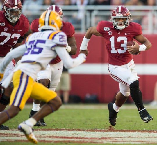 Alabama quarterback Tua Tagovailoa (13) runs the ball at Bryant-Denny Stadium in Tuscaloosa, Ala., on Saturday, Nov. 9, 2019. LSU defeated Alabama 46-41.