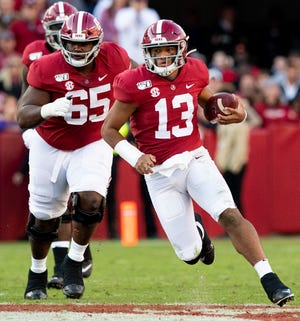 Alabama quarterback Tua Tagovailoa (13) scrambles for yardage against LSU at Bryant-Denny Stadium in Tuscaloosa, Ala., on Saturday November 9, 2019.