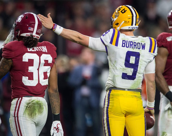 LSU quarterback Joe Burrow (9) signals for a first down on late in the fourth quarter at Bryant-Denny Stadium in Tuscaloosa, Ala., on Saturday, Nov. 9, 2019. LSU defeated Alabama 46-41.