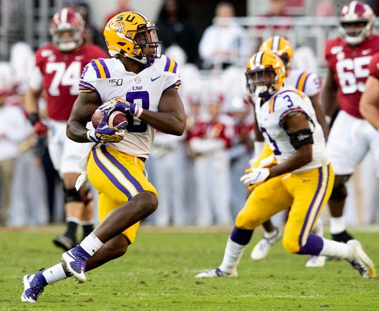 LSU linebacker Patrick Queen (8) intercepts an Alabama pass at Bryant-Denny Stadium in Tuscaloosa, Ala., on Saturday November 9, 2019.