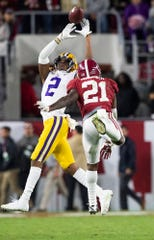 A pass goes over LSU wide receiver Justin Jefferson (2) as Alabama defensive back Jared Mayden (21) defends  at Bryant-Denny Stadium in Tuscaloosa, Ala., on Saturday November 9, 2019.