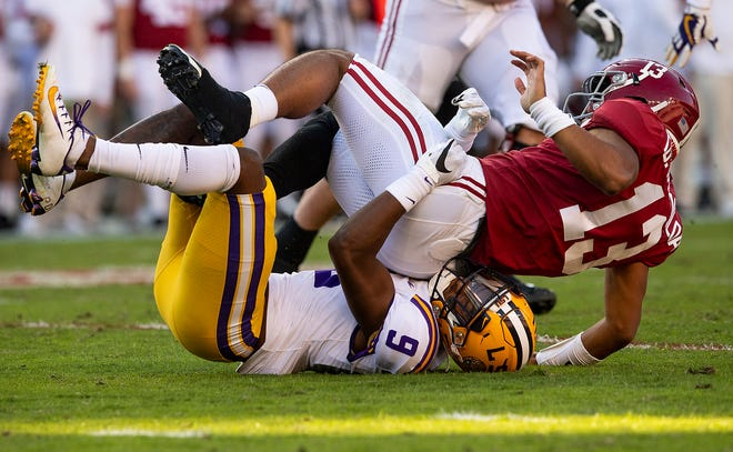 LSU safety Marcel Brooks (9) tackles Alabama quarterback Tua Tagovailoa (13) after he released a pass at Bryant-Denny Stadium in Tuscaloosa, Ala., on Saturday November 9, 2019.