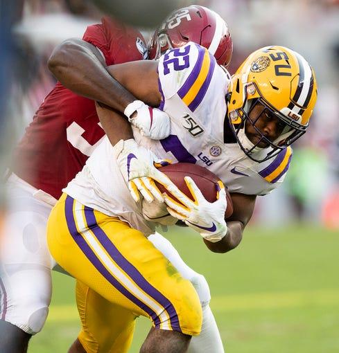 Alabama linebacker Shane Lee (35) stops LSU running back Clyde Edwards-Helaire (22) at Bryant-Denny Stadium in Tuscaloosa, Ala., on Saturday November 9, 2019.