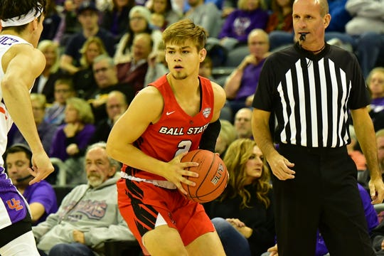 Ball State freshman guard Luke Bumbalough handles the ball for the Cardinals in their game against Evansville. The Purple Aces would win.