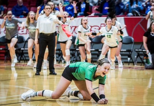 New Castle's Zoe Conway falls to the ground in excitement during their state final match at Worthen Arena Saturday, Nov. 9, 2019. New Castle beat Hamilton Southeastern 3-1.
