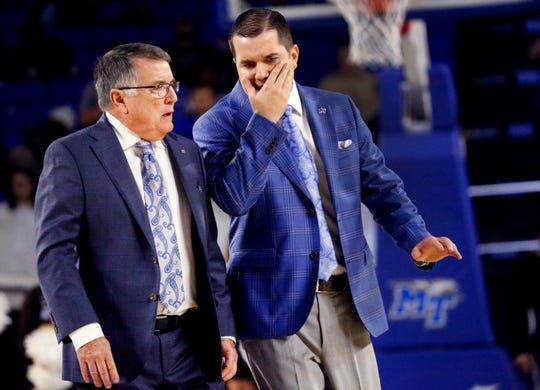 MTSU's head coach Rick Insell and MTSU's assistant coach Matt Insell talk as they cross the court to go into the locker at halftime of the game against Kentucky on Sunday, Nov. 10, 2019, at MTSU.