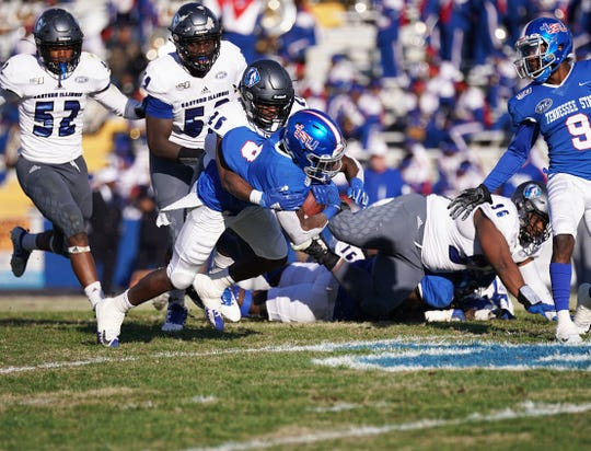 Tennessee State running back Te'kendrick Roberson is tackled from behind in Saturday's game against Eastern Illinois at Hale Stadium.