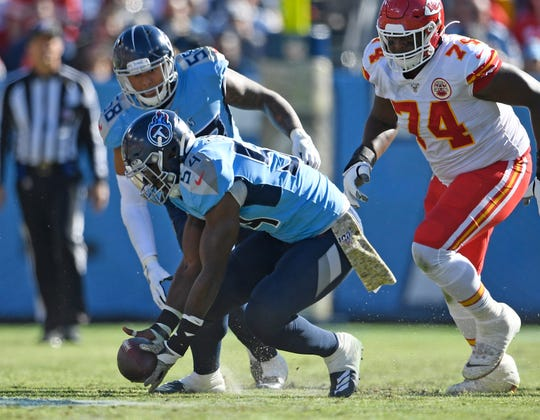 Titans inside linebacker Rashaan Evans (54) scoops up a Chiefs fumble and takes it in for the team's second touchdown in the second quarter Sunday.