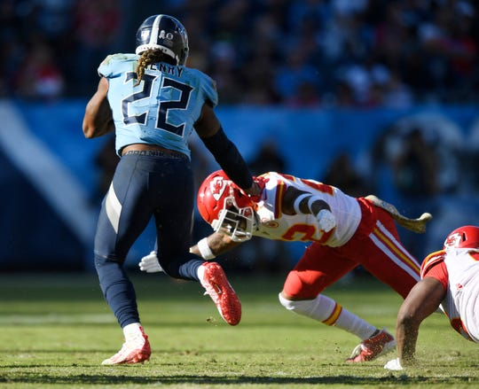 Titans running back Derrick Henry (22) gets by Chiefs defenders on his way to a 68-yard touchdown during the third quarter Sunday.