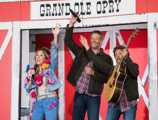 """Kathie Lee Gifford dressed as Miley Cyrus, left, Blake Shelton and Hoda Kotb dressed as Blake Shelton appear on NBC's """"Today"""" show Halloween special at Rockefeller Plaza on Tuesday, Oct. 31, 2017, in New York."""