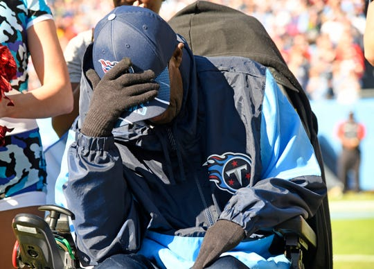 George Thomas gets emotional as he receives a custom motorized wheelchair from Permobile of Lebanon during the first quarter at Nissan Stadium Sunday, Nov. 10, 2019 in Nashville, Tenn.