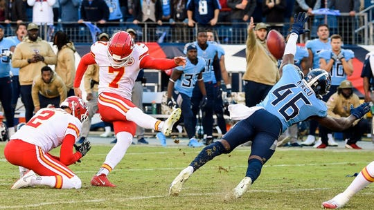 Titans defensive back Joshua Kalu (46) blocks a field goal by Chiefs kicker Harrison Butker (7) as time expires in the fourth quarter Sunday.