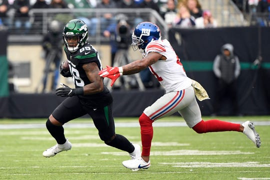 New York Jets tight end Chris Herndon rushes with pressure from New York Giants safety Antoine Bethea (41) in the first half. The New York Jets host the New York Giants in an NFL game on Sunday, Nov. 10, 2019, in East Rutherford.