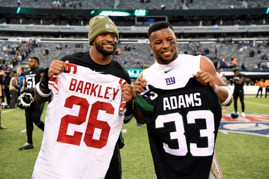 New York Jets safety Jamal Adams, left, and New York Giants running back Saquon Barkley, right, pose after trading jerseys after the game. The New York Jets defeat the New York Giants, 34-27, on Sunday, Nov. 10, 2019, in East Rutherford.