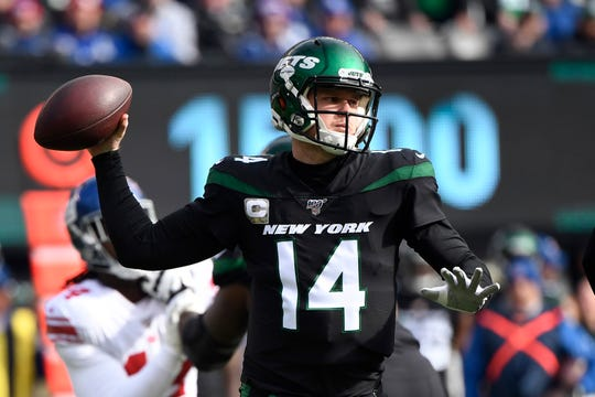 New York Jets quarterback Sam Darnold (14) throws against the New York Giants in the first quarter during an NFL game on Sunday, Nov. 10, 2019, in East Rutherford.