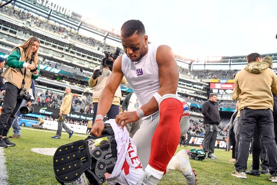 New York Giants running back Saquon Barkley takes off his jersey to give to New York Jets safety Jamal Adams (not pictured) after the game. The New York Jets defeat the New York Giants, 34-27, on Sunday, Nov. 10, 2019, in East Rutherford.