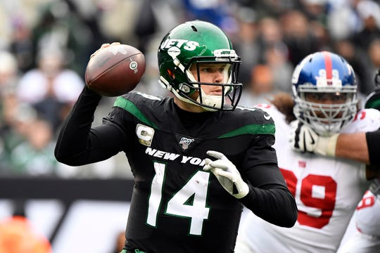 New York Jets quarterback Sam Darnold (14) looks to throw against the New York Giants in the first half of an NFL game on Sunday, Nov. 10, 2019, in East Rutherford.
