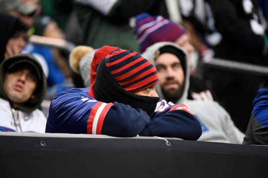 A disappointed Giants fan watches as his team loses to the New York Jets, 34-27, on Sunday, Nov. 10, 2019, in East Rutherford.