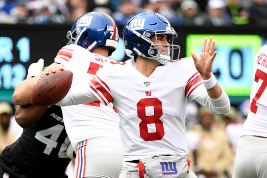 New York Giants quarterback Daniel Jones (8) throws against the New York Jets in the first half of an NFL game on Sunday, Nov. 10, 2019, in East Rutherford.